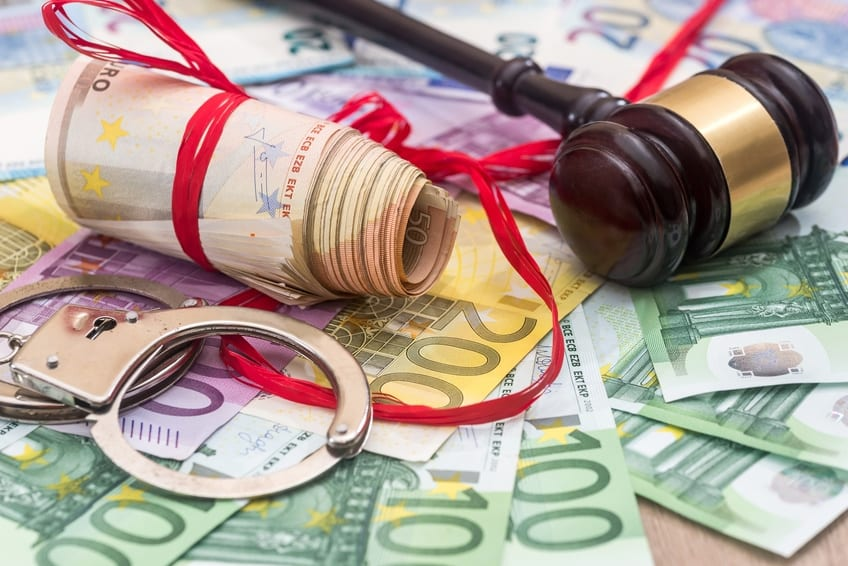 European Enforcement Orders (EEO) | Handcuffs and euro bills and wooden gavel as crime concept
